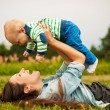 Mother with baby outdoors — Stock Photo