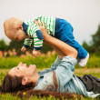Mother with baby outdoors — Stock Photo #40710355