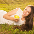Stock Photo: Woman eating apple