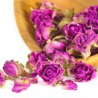 Spa concept with dried pink and purple rose buds. — Stock Photo