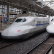 Two Shinkansen trains depart from rail station. — Stock Photo #34328741
