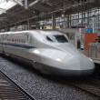 Stock Photo: Shinkansen train departs from rail station.