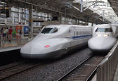 Two Shinkansen trains depart from rail station. — Stock Photo