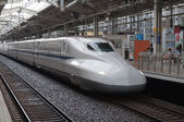 Shinkansen train departs from rail station. — Stock Photo