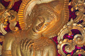 Gold gilding buddha statue — Stock Photo