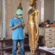 Artisans renew damaged by war buddhstatues in workroom at former Royal Palace — Stock Photo #35735551