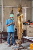 Artisans renew damaged by war buddha statues in the workroom at the former Royal Palace — Stock Photo