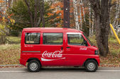 Tiny minibus delivers Coca-cola to remote locations in Japanese mountains. — Stock Photo