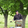 Unidentified musician plays on barrel organ at the market on May 14, 2014 in Tbilisi, Georgia — Stock Photo #46665915