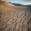 Stock Photo: Sand dune look like wave in Death Valley