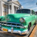 CIEN FUEGOS-JANUARY 1:Vintage Cadillac in a culture neighborhood — Stock Photo #46406523