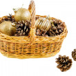 New year basket with pine cones and Christmas balls — Stock Photo