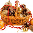 New year basket with pine cones and Christmas decorations — Stock Photo