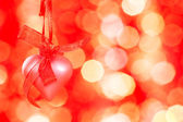 Pink heart on a red background — Stock Photo