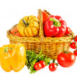 Still life with vegetables in a wicker basket on a white backgro — Stock Photo