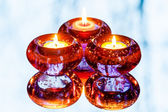 Three candles and reflection in the mirror — Stock Photo