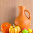Still life with jug, pumpkins and Easter eggs — Stock Photo #42877835