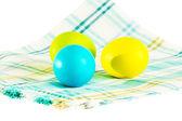 Three Easter eggs on a checkered napkin on a white background — Stock fotografie