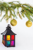 Decorative lantern in the snow and fur-tree branch with Christma — Stock Photo