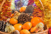 Christmas basket with fruit, pine cones and a bottle of wine — Stockfoto