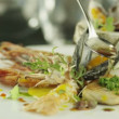 Chef Garnishing Delicious Selection of Seafood with Oil — Stock Video