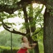 Pretty Girl Playing Badminton in Nature. — Stock Video