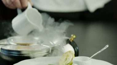 Chef Serving Dish with Fish Fillet. Close-Up. — Stock Video
