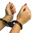 Female hands in cuffs — Stock Photo #29449159