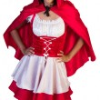 Little red riding hood standing with hand on hips — Stock Photo