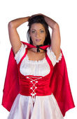 Little red riding hood with her hands in her hair — Stock Photo