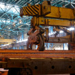 Stock Photo: Crane carries metal in shop