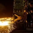 Workers cater for equipment in the steel producing workshop — Stock Photo