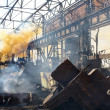 Scrap metal and smoke in backyard of factory — Stock Photo #31446645