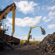 Two excavators working on scrapyard. — Stock Photo #31447213
