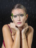Portrait of a girl under the rain in studio — Stock Photo