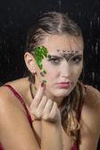 Portrait of a girl under the rain in studio — Stock Photo