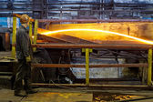 Worker cater for equipment in the steel producing workshop — Stock Photo