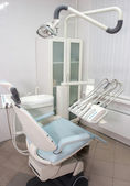 Modern dentist chair in a medical room — Stok fotoğraf