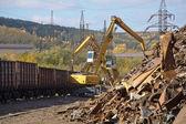 Excavator working on the scrapyard. — Stock Photo