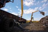Two excavators working on the scrapyard — Stock Photo