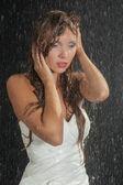 Wet bride under rain — Stock Photo