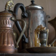 图库照片: Old oriental teapots and candlestick