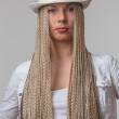 Portrait of blond girl in white hat — Stock Photo