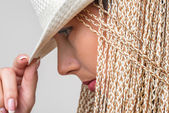 Closeup portrait of blond girl in white hat — Stock Photo