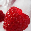Ice cubes with raspberries — Stock Photo
