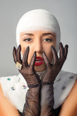 Beautiful woman with bandages on her head — Stock Photo