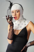 Beautiful woman with bandages on her head with cigarette — Stock Photo