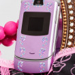 Pink mobile phone decorated with rhinestones — Stock Photo