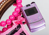 Pink mobile phone decorated with rhinestones — Foto Stock
