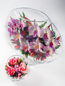 Flowers in a glass aquarium — Stock Photo